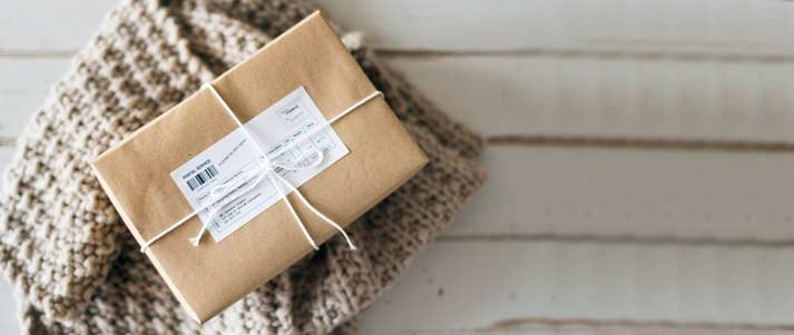 parcel with a string bow and brown wrapping paper