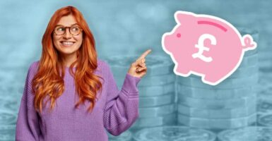 woman pointing at piggy bank in front of pound coins