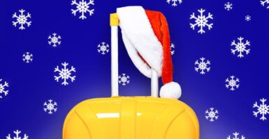 Suitcase with santa hat