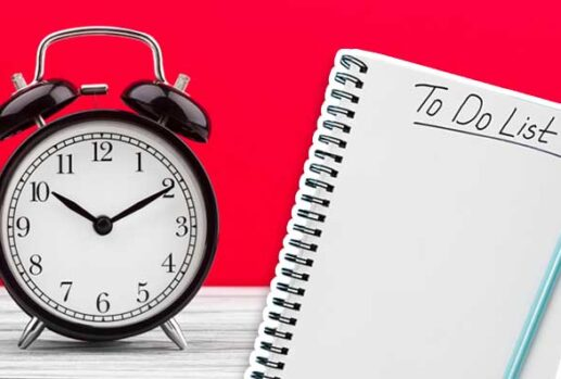 alarm clock and to do list against red background