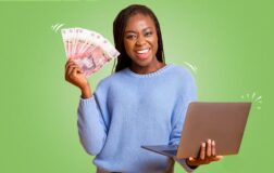 woman with money and a laptop